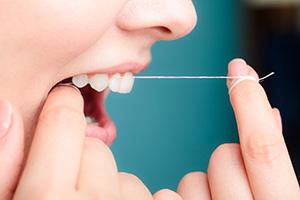 Как пользоваться зубной нитью?